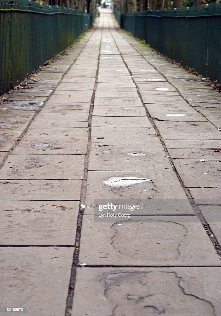 Long, old stone walkway and railings : Stock Photo