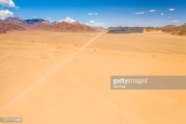 Long open road cutting through the desert , Namib-Naukluft Park, Namibia.
