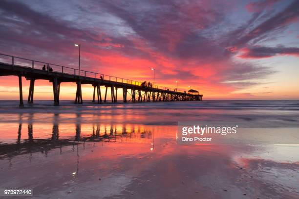 long pier over sea at sunset, adelaide, australia - adelaide stock pictures, royalty-free photos & images