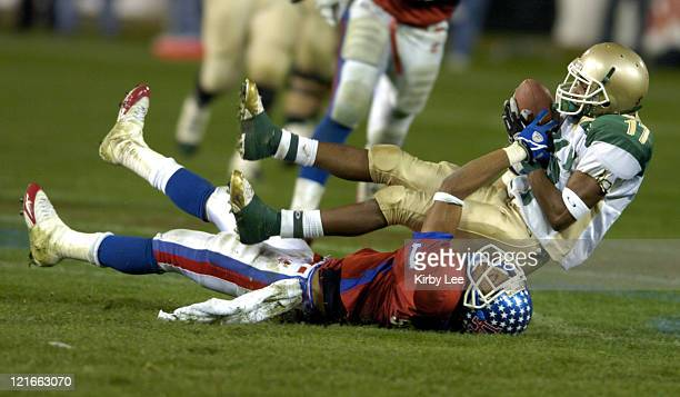 Long Poly High receiver Travon Patterson makes a reception despite the efforts of Orlando Sandrick of Los Alamitos during 21-6 victory in the...