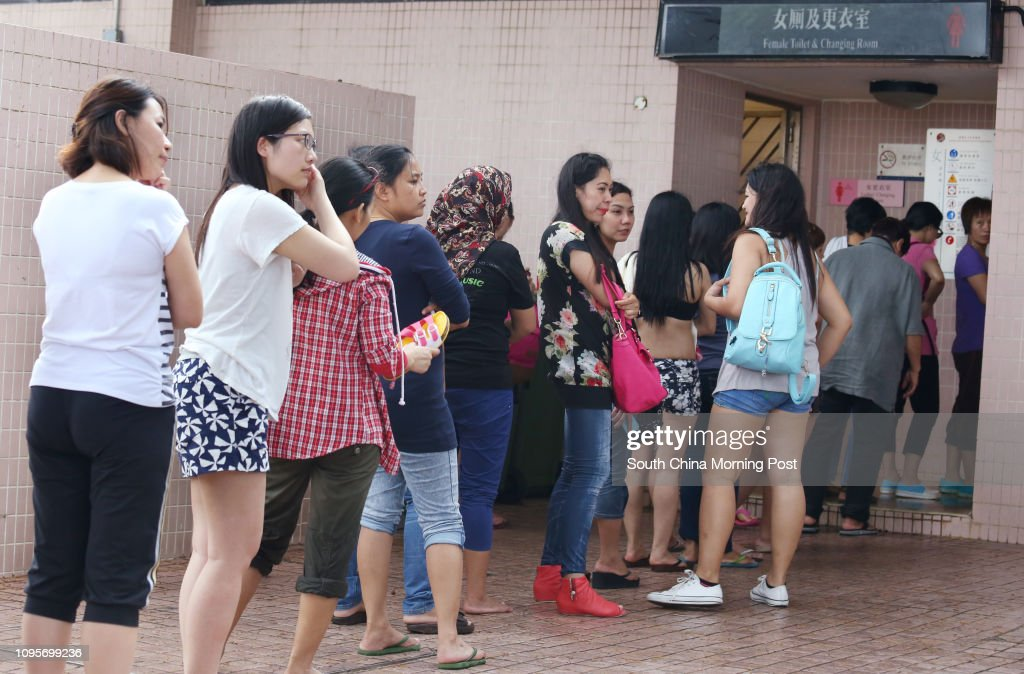 Long queue is seen outside female toilet and changing room as beachgoers flock to Shek O beach on the first day of the Labour Day Golden week holiday. 01MAY15 : News Photo
