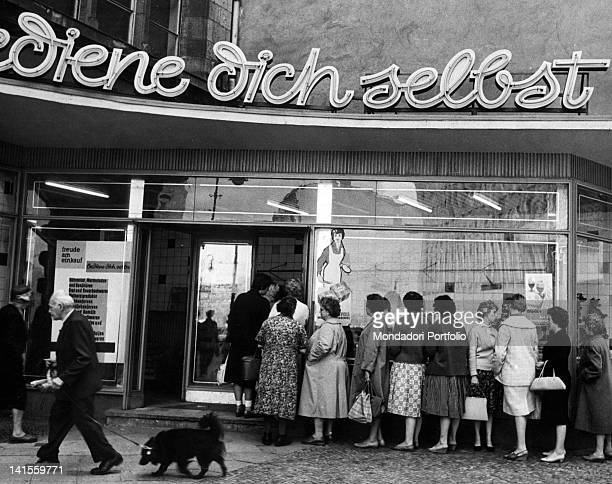 A long queue of German women waiting to enter a cafeteria in East Berlin East East Berlin August 1961