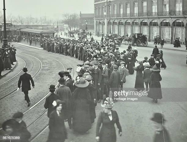 Long queue of people at Blackfriars Tramway shelter London 1912 People waiting to board trams near Blackfriars Bridge at 125 pm