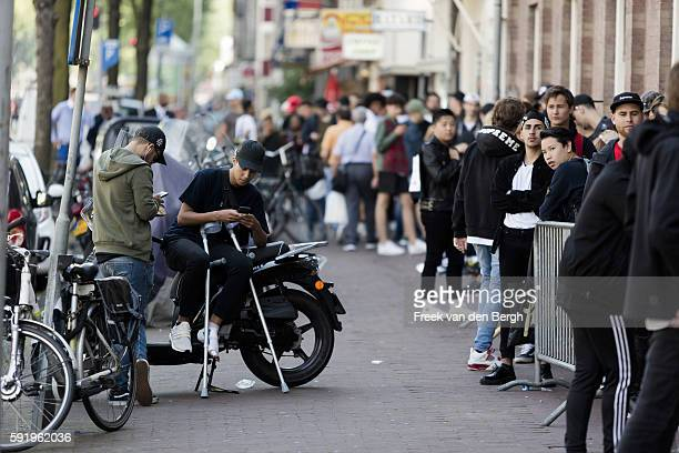 Long queue of people in front of the Kanye West temporary PABLO store at the Rozengracht on August 19, 2016 in Amsterdam, the Netherlands.