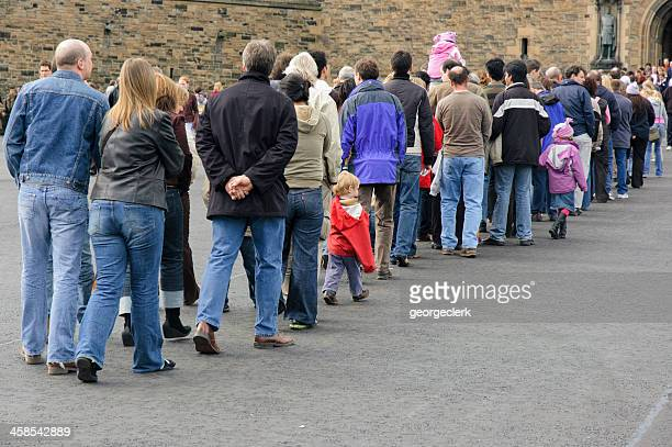 long queue of people - long stock photos and pictures