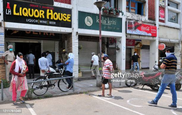Long queue outside a liquor shop in Sector 9 after relaxations allowed their opening, on May 4, 2020 in Chandigarh, India. A large number of people...