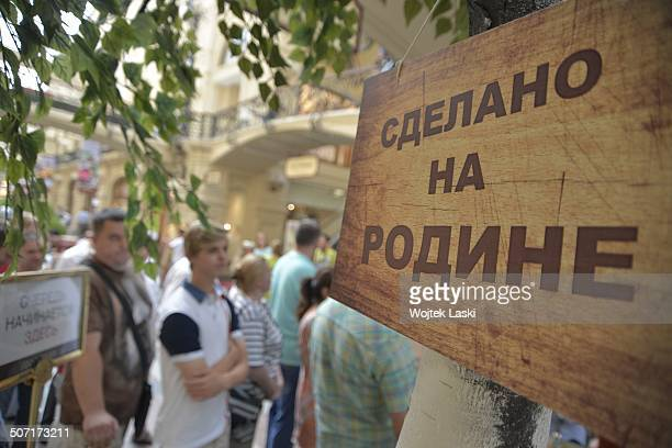 Long queues of customers waiting to buy T-shirts depicting Russian President Vladimir Putin, at the GUM shopping mall in Kitai-gorod, Moscow, Russian...