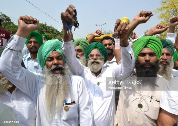 Long queues to tractor parked outside DC office during protest by Bharti Kissan union members against diesel price hike on June 1 2018 in Jalandhar...