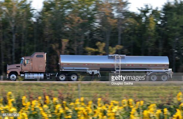 long range semi tractor and trailer with liquid container on the highway - international brotherhood of teamsters stock photos and pictures