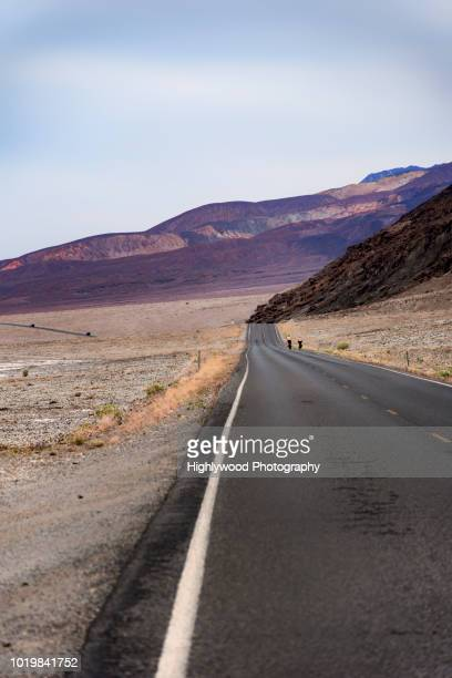 long road through death valley - highlywood stock photos and pictures