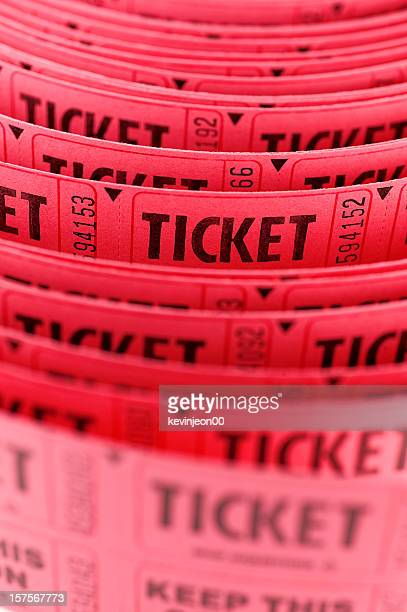 Long roll of pink tickets close up