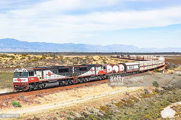 long sct interstate freight train in vast outback landscape - refrigerator truck stock pictures, royalty-free photos & images