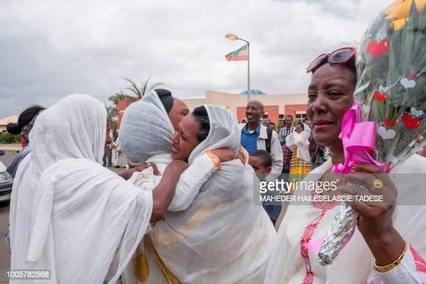 Long separated families meet at Asmara International airport on July 21 during the first week after Ethiopian airlines resumed flight to Asmara,...