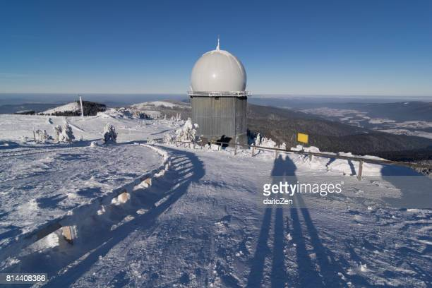Long shadows on summit of Great Arber mountain in winter, Bavarian Forest , Bavaria, Germany