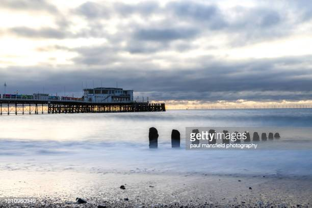 long shutter image of worthing beach and pier - west sussex stock pictures, royalty-free photos & images