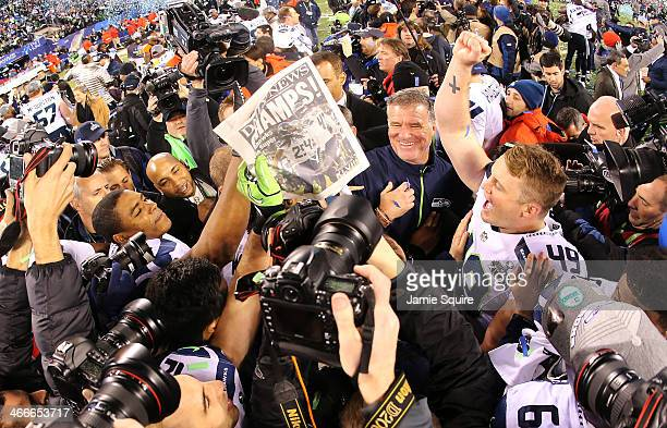 Long snapper Clint Gresham of the Seattle Seahawks celebrates with teammates on the field after winning Super Bowl XLVIII at MetLife Stadium on...