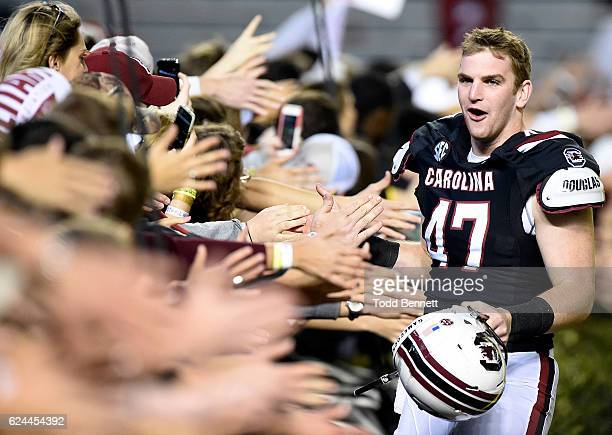 Long snapper Drew Williams of the South Carolina Gamecocks celebrates with fans after defeating the Western Carolina Catamounts on November 19 2016...
