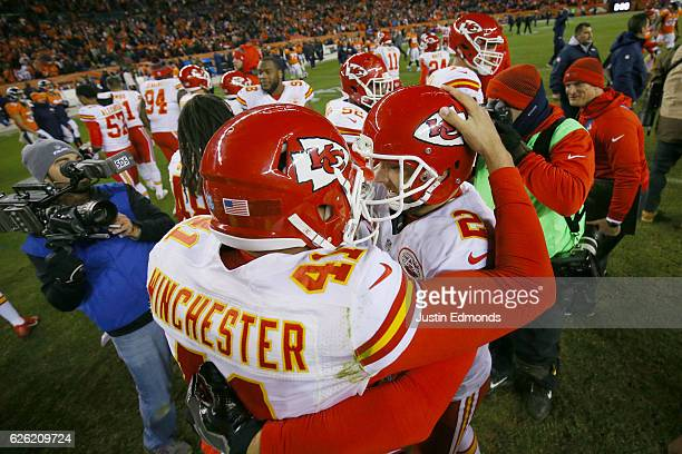 Long snapper James Winchester of the Kansas City Chiefs and Dustin Colquitt celebrate after kicker Cairo Santos made a gamewinning field goal in...
