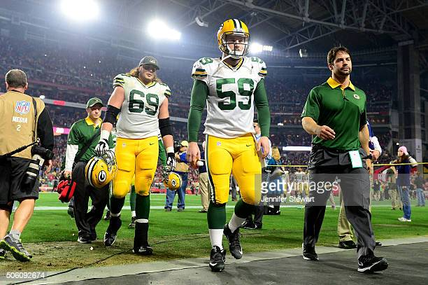Long snapper Rick Lovato and tackle David Bakhtiari of the Green Bay Packers walk off the field after losing in overtime to the Arizona Cardinals...