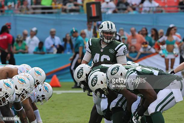Long snapper Tanner Purdum is set to snap amid the special teams lines of the New York Jets and the Miami Dolphins at Sun Life Stadium on December 28...