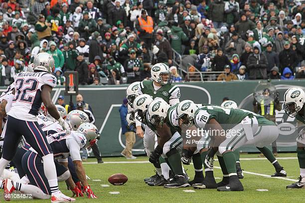 Long Snapper Tanner Purdum of the New York Jets is set to snap the ball against the New England Patriots at MetLife Stadium on December 21 2014 in...