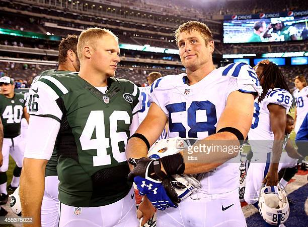 Long snapper Tanner Purdum of the New York Jets speaks with linebacker Andy Studebaker of the Indianapolis Colts following a preseason game at...