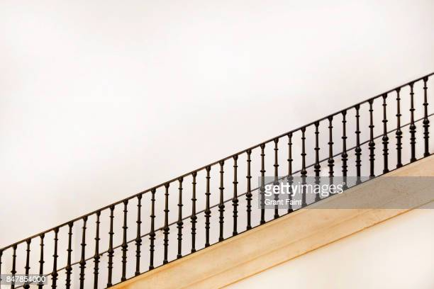 a long staircase in public building. - railing stock pictures, royalty-free photos & images