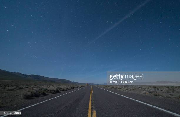 A long straight road and starry night sky