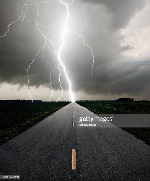 Long straight road meeting a lightning bolt