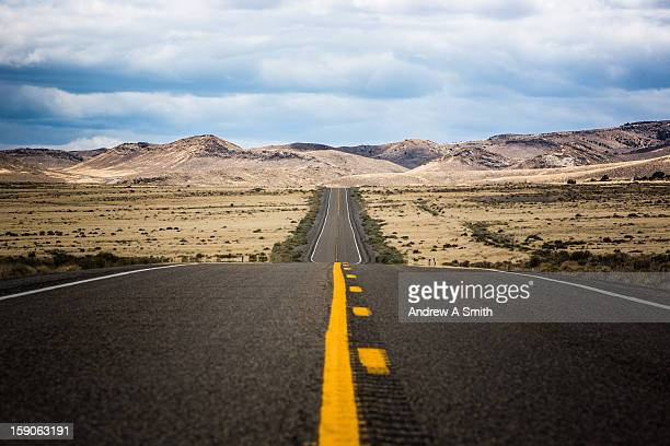 long straight road - double yellow line stock photos and pictures