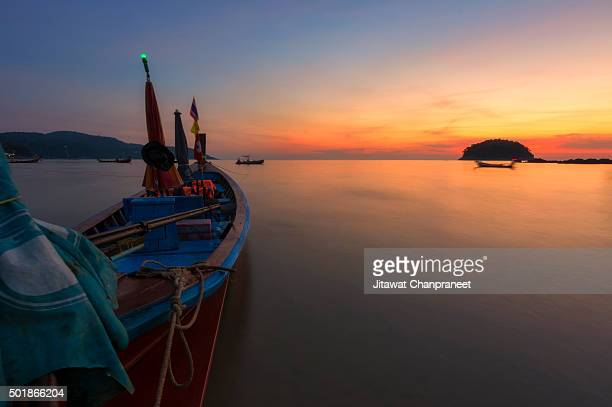 Long Tail Boat and sunset , Phuket Thailand