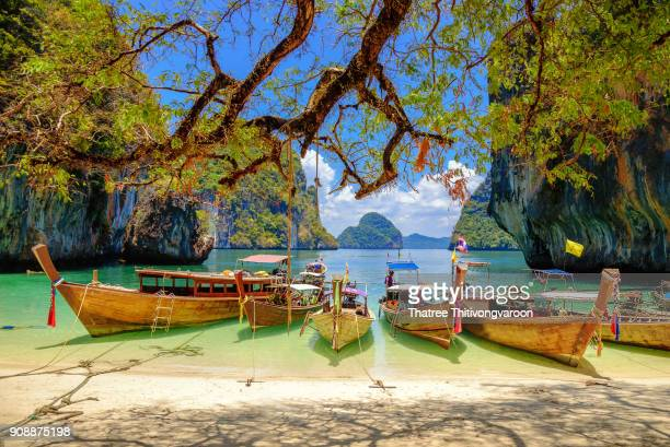 long tail boat at tropical beach scenery, andaman sea, view of koh hong island krabi,thailand - phuket province stock pictures, royalty-free photos & images