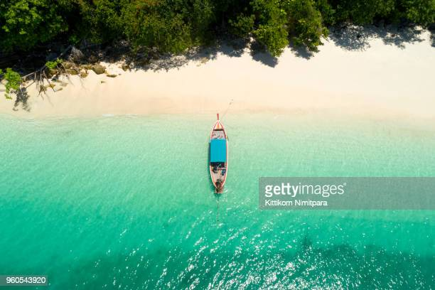 long tail boat on the beach.wonderful background.aerial view from andaman beach. - phuket province stock pictures, royalty-free photos & images