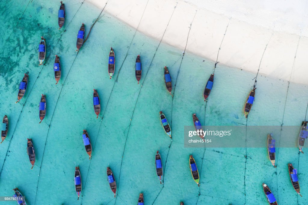 Long tail boat on the clear blue sea water beach. Wonderful background. Aerial view from Lipe Island in Thailand Andaman beach. : Stock Photo