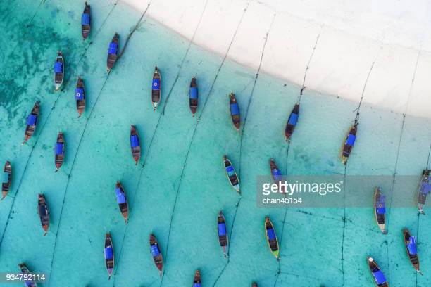 Long tail boat on the clear blue sea water beach. Wonderful background. Aerial view from Lipe Island in Thailand Andaman beach.