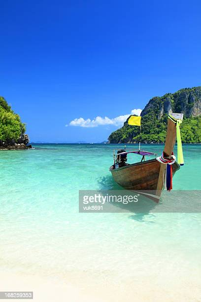 Long tail wooden boat at Krabi island beach