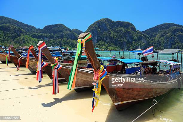 Long tail wooden boats at the beach