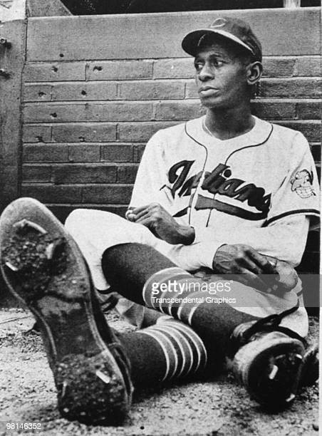 Long, tall Satchel Paige rests in the Cleveland Indians bullpen during a game at Metropolitan Stadium in Cleveland in 1948.