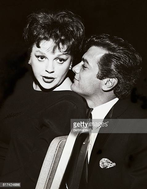 Long time admirer of Judy Garland's talents pal Tony Curtis welcomes the veteran singer back to the social swirl of Hollywood Judy had just returned...
