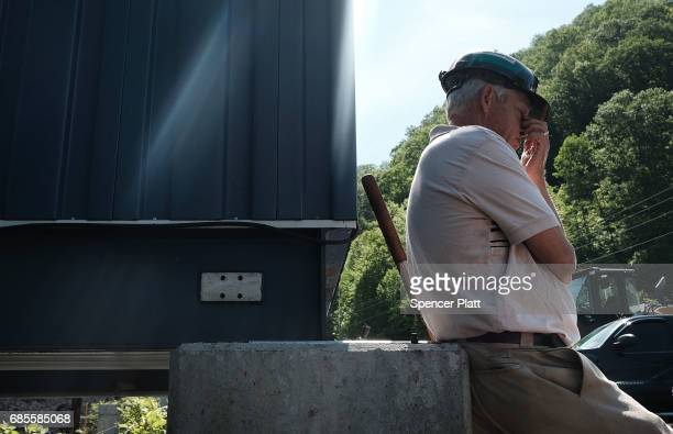 Long time coal miner Billy Griffith pauses while working at a coal prep plant on May 19 2017 outside the city of Welch West Virginia West Virginia a...