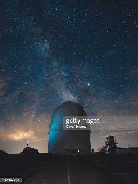 long time exposure night landscape with milky way galaxy. - observatory stock pictures, royalty-free photos & images