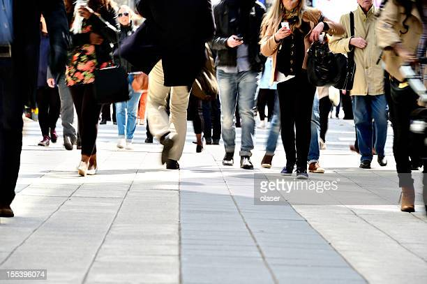 long time exposure of pedestrians - pedestrians stock photos and pictures
