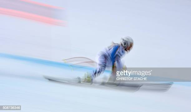 TOPSHOT Long time exposure picture shows Ann Kartin Magg from Germany racing down the hill during the ladies downhill competition race at the FIS...