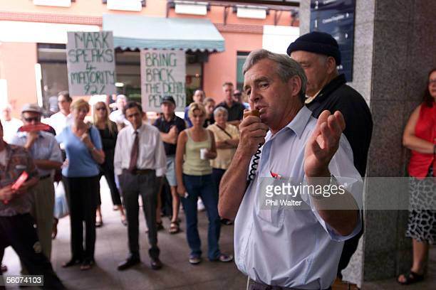 Long time Mark Middleton supporter Garth McVicar speaks outside the Auckland District Court where a group of Middleton supporters have gathered for...