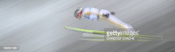 Long time picture of Norway's Haavard Klemetsen competing during the World Cup Nordic Combined individual jumping competition in Oberstdorf, southern...