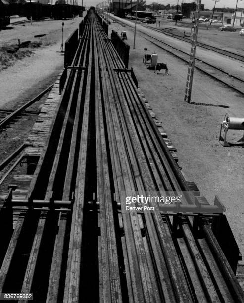 Long Track Rails in Transit Continuous welded rails each a quartermile long were transported through Liberal Kan on a 27car freight train en route to...