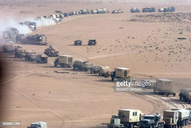 A long US military convoy is seen moving inside an unspecified area of southern Iraq 21 March 2003 US and British invasion forces were poised to...