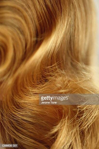 Long, wavy blonde hair, full frame
