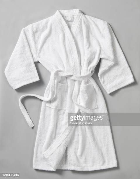 Long white bathrobe on the gray surface