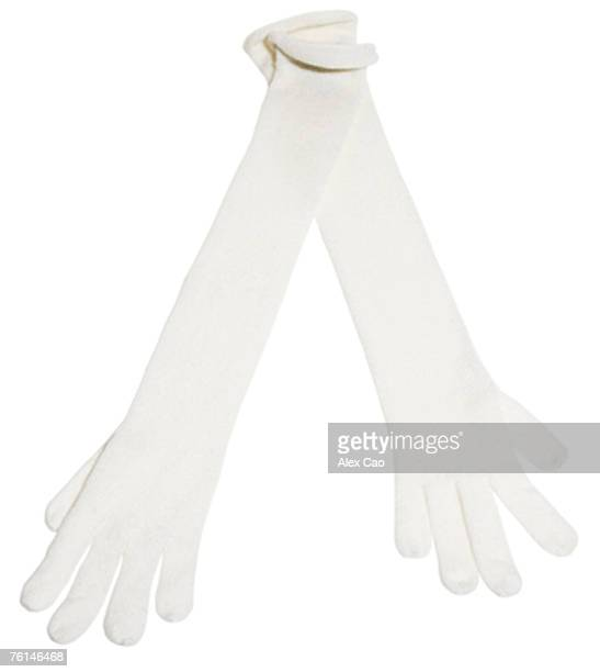 Long white knit gloves, close-up